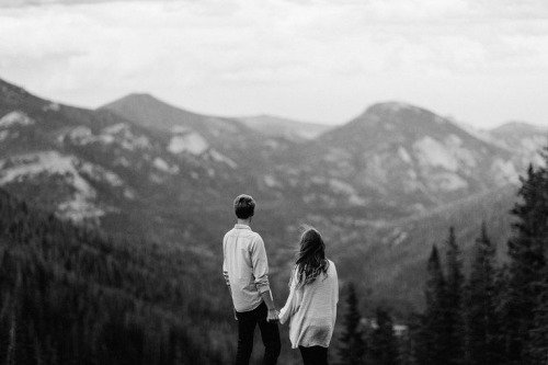 couple overlooking rocky mountains colorado engagement photographer